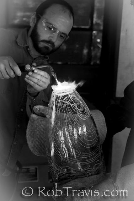 Glassblower finishing off the piece